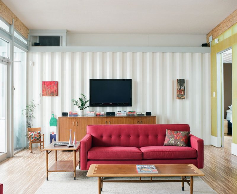 tv-placed-on-the-wall-behind-the-red-couch-800x653